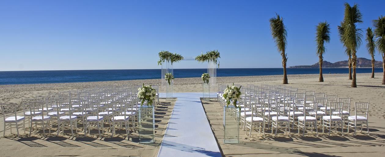 A stunning white Barceló beach wedding set up with the sparkling blue ocean as your destination wedding backdrop.