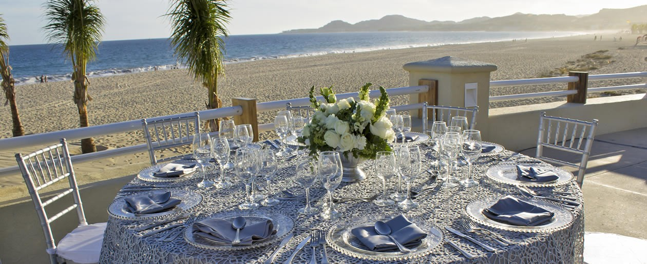 A terrace wedding table setup at the Barceló Grand Faro Los Cabos with a reception table.