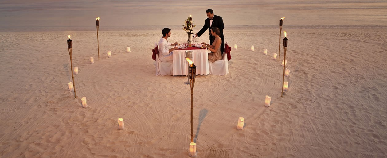 A stunning romantic wedding dinner setup just for the two at the Barceló Maya Palace Deluxe.