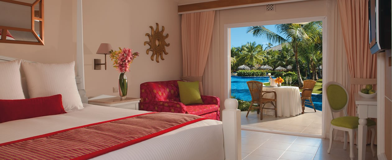 The Deluxe Swim-Out offers flat screen TV, swim-out access to the pool and luxurious bedding.