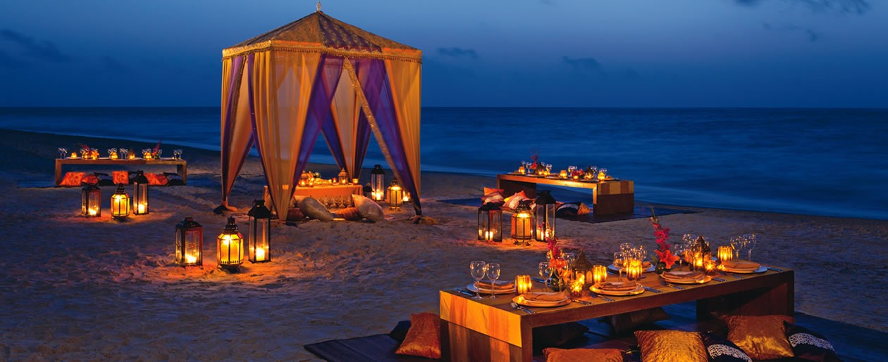 This Hindu Theme Party setup allows guests to sit in Indian style and enjoy an authentic meal in the evening, as they feel the cool ocean breeze on the beach.