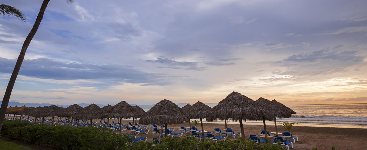 The stunning view of Banderas Bay at the Hard Rock Vallarta with picturesque palapas.