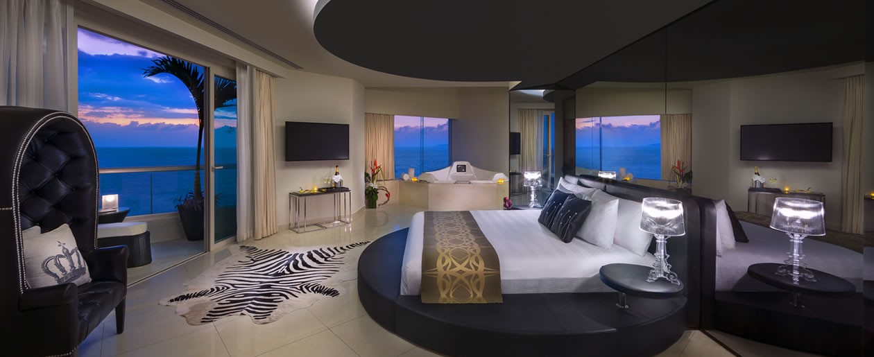 Escape on to your destination wedding and honeymoon at the Rock Star Suite Bedroom.