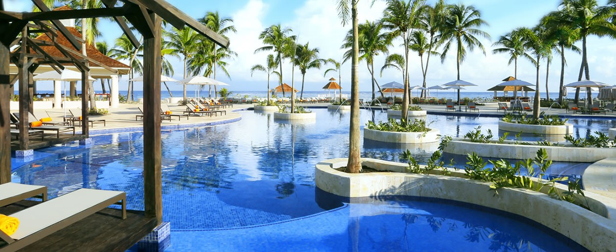 Sprawling resort pools with swim-up bars.