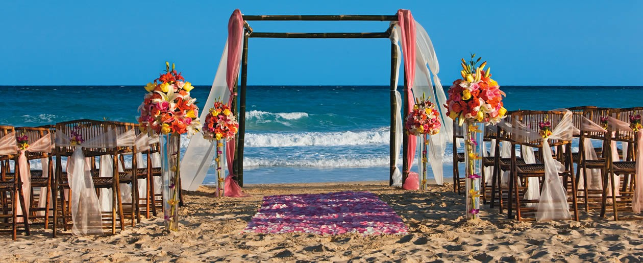A beautiful Now Jade Riviera Cancun wedding set-up on the beach.