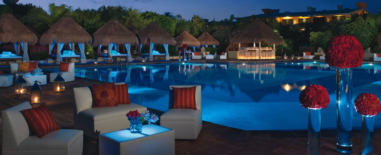 A party set-up at night located around the Preferred Club pool.