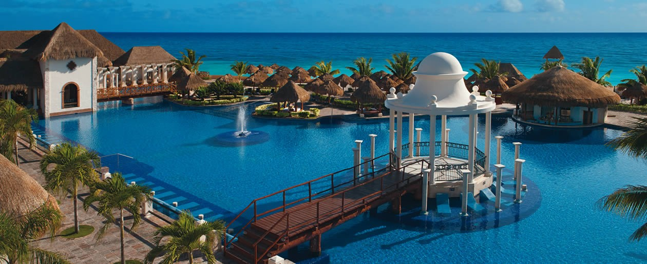 A view overlooking the pristine swimming pool with stunning views of the azure Caribbean Sea.