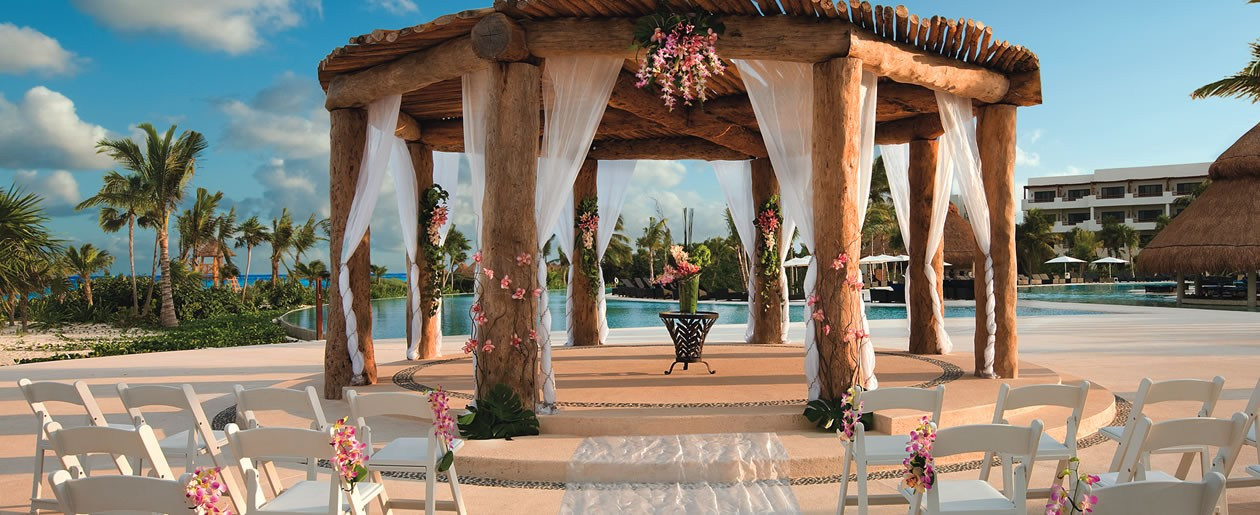 The beautifully decorated wedding gazebo situated in the center of Secrets Maroma Beach near the main pool offering stunning views of the resort and dazzling beach.