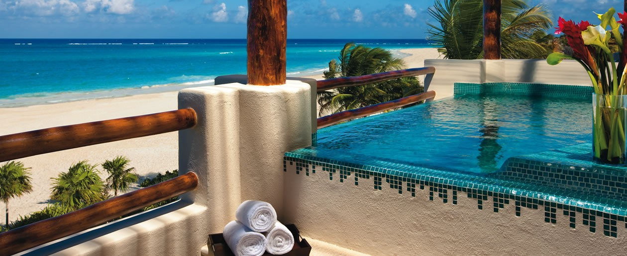Presidential suite terrace featuring a Jacuzzi for two and shimmering Caribbean views.