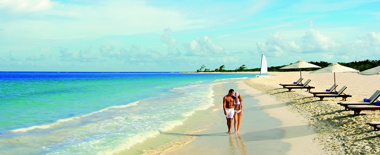 A couple enjoying the sandy-white Maroma Beach with the crystal clear Caribbean view.