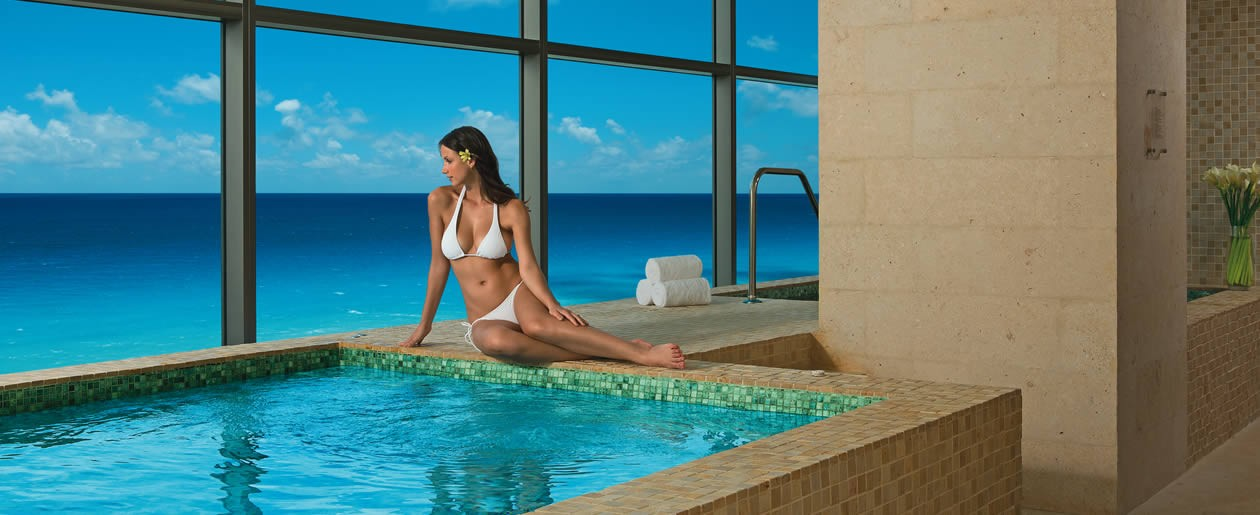 The Jacuzzi at the Secrets Spa by Pevonia boasts stunning ocean views.